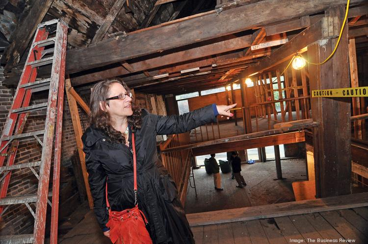 Susan Herlands Holland, executive director, Historic Albany Foundation, shows off the interior of 48 Hudson Ave. in Albany. Historians say the building dates back to 1728; its last owners were reluctant to move ahead with their plans for the property because of uncertainty over a convention center nearby.