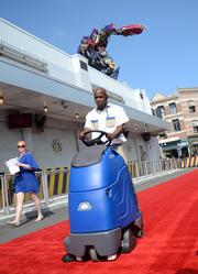 What must be a new generation of Transformer robots assumed his duties that morning, handling red carpet security in the form of a vacuum. Well done, soldier.