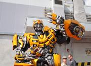 Bumblebee waves to fans on his way down the red carpet.