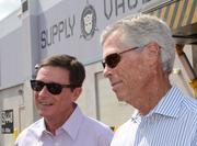 Tom Williams, chairman & CEO of Universal Parks & Resorts, and Bill Davis, president and COO of Universal Orlando Resort, stop to answer questions.
