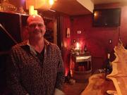 Tim Gaber, owner of Pittsburgh Winery in the Strip District, manning the bar of his tasting room.