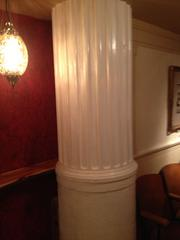 A marble column in the middle of the tasting room revealing the building's former use as a bank. The column was originally part of a teller window.