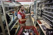 Michael Alexander, an employee of Tractor Supply Company in Hendersonville, stocks hand tools made in China and Taiwan.