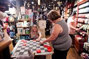 Jeannie Smith plays checkers with her granddaughter Allie Steelman at Cracker Barrel on Charlotte.
