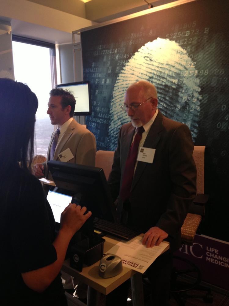 Bob Helwig of UPMC shows off how a pilot biometrics program can identify a patient through finger prints at UPMC's enterprise data analytics open house.