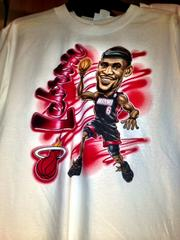 Miami Heat t-shirt with LeBron James caricature.