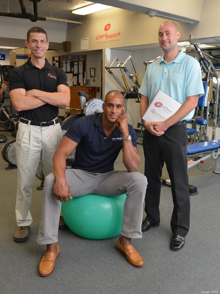 Joining forces are, from left, Mike Turner of OrthoSport Hawaii and Phil Martin and Bryan Watkins of Clark Hatch Fitness Center.