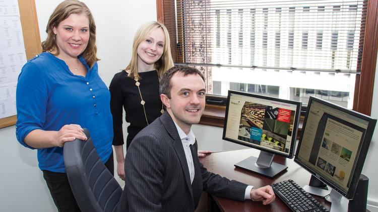 Hodgson Russ employees who had a role in planning the law firm's new website include event planning specialist Jessica Marinelli, left, communications manager Caitlin Hartney and attorney Jordan Walbesser, who was a member of the website committee.