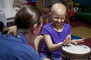 Lydia Haycrafdt, 7, followed Brett Northrup's lead during a music therapy session at Kosair Children's Hospital.