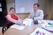 Charlie Marshall and stroke patient Jennifer Riggs worked together during an art therapy session.
