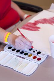 Jennifer Riggs chooses a color during her art therapy session.