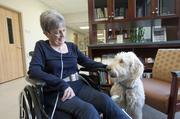 Joyce Akers enjoyed a visit from Lily, a goldendoodle who is part of a therapy program at Southern Indiana Rehabilitation Hospital, during her rehab stay there.
