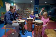 Brett Northrup, a certified music therapist, held a drumming therapy session with Lydia Haycraft and Meena Elgarmi recently at Kosair Children's Hospital.