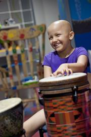 Lydia Haycraft, 7, joyfully played her drum during a music therapy session at Kosair Children's Hospital.