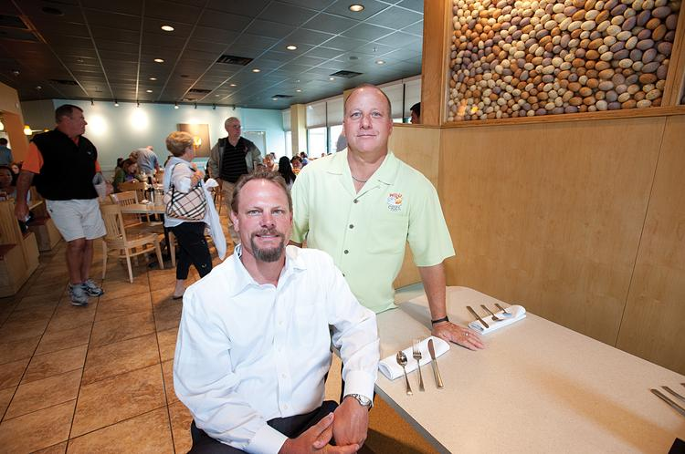 Shane Hall, seated and J.D. Rothberg, have turned their Wild Eggs concept into a nationally franchised business. They are shown here at their Westport Village location.