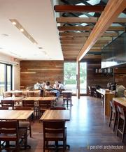 The inside of Qui features antique heart pine repurposed from the original structure.