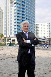 Architect Carlos Ott next to Apogee Beach condominium in Hollywood, with him providing a conceptual design for The Related Group.