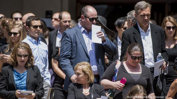 Mourners exit the Stanford Memorial Auditorium on Stanford University after the memorial service of former SurveyMonkey.com CEO David Goldberg.