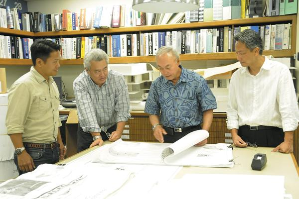 Reviewing plans for a school cafeteria on Maui are Design Partners team members, from left, Dayton Wong, Michael Muromoto, Vernon Inoshita and Nhan Nguyen.