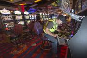 Christopher Fredrickson, a slot machine technician, places tamper-proof devices on the all-new machines.