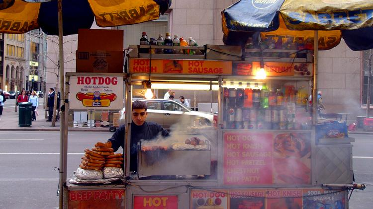 A hot dog cart open for business in Manhattan. (Photo by Kathleen Conklin. Used under Creative Commons license.)