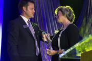 Here, CBJ Publisher Kevin Pitts presents the Women In Business Lifetime Achievement Award to Judy Rose of UNC Charlotte. The awards luncheon was held this week, and more photos will be coming soon to our website.