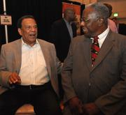 Andrew Young, left, with Hank Aaron