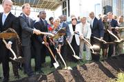 Doug Shipman, second from left, and other city leaders break ground on the National Center for Civil and Human Rights on June 27, 2012.