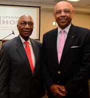 Willie Clemens of Morehouse School of Medicine and John Grant at an Operation Hope forum in Atlanta on April 16.
