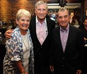 Carolyn and Bill Curry, left, and John Schuerholz at Charlie Loudermilk's 85th birthday party on July 13, 2012.