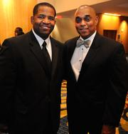 Atlanta City Council President Ceasar Mitchell, left, and Michael Russell at the UNCF Mayor's Masked Ball on Dec. 15, 2012.