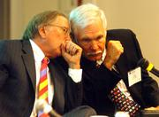 (left) Ted Turner, Former Senator Sam Nunn talk with Ted Turner during a panel discussion on Preparing for Pandemics at Georgia Tech Global Learning and Conference  Center. Tuesday.photo/Byron E. Small