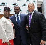 Leona Barr Davenport of the Atlanta Business League, from left; Mayor Kasim Reed, and Tommy Dortch.