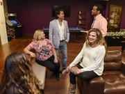 Co-workers join Gabriella Aronson, vice president, (front right) and Damian Maldonado, president, (back left) in an area of the American Financing office designed for having fun.