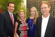 Jeff Lovell, left, son of NASA astronaut Jim Lovell ('Houston, we have a problem'), his wife Annie, their daughter Allie, and Bob Lowman at the book launch in Houston.