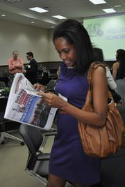 Fabiola Fleuranvil of Blueprint Creative Group looks for her photo.
