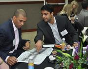 Chris Drew of HFF and Nitin Motwani of Miami Worldcenter finding their photos.