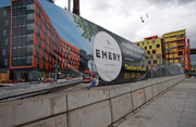 An image of the Emery apartments, under construction to the right at 3155 S.W. Moody Ave., adjacent the OHSU Wellness Center at Portland's South Waterfront. The Emery is the debut project for the 33-acre redevelopment known as Zidell Yards.