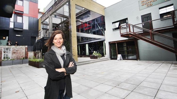Developer Liz Dunn is pictured in the courtyard of her under-construction Chophouse Row located in the Capitol Hill neighborhood of Seattle, Washington as seen May 13, 2015.
