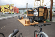 The Emery is being marketed to prospective renters at a trailer parked outside OHSU's South Waterfront Wellness Center. The project is in the background.