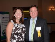 Monique Yeager and C-Level honoree Brad Smith of Romacorp Inc.