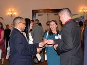 Guests trade business cards during pre-event networking.