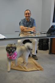 Kelley Drye & Warren partner, Gonzalo Mon and his dog Kira. 25 dogs joined their owners at the Kelley Drye & Warren's office for Take Your Dog to Work Day on Friday.