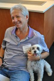 Kelley Drye & Warren partner, Joe Hoffman and his dog Snickers. Friday is the 15th annual Take Your Dog to Work Day.