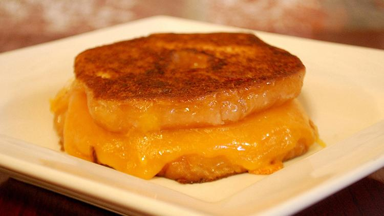 """Shark Tank veteran Tom & Chee in Cincinnati is known for its grilled cheese and tomato soup, and for the """"world famous grilled cheese donut."""" The Today Show has named the $3.50 item the best sandwich in America, and there are versions with caramelized banana, smore and more."""