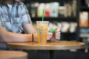 Starbucks partners with Spotify to boost loyalty membership, replace CDs