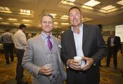 Business Journal Editor in Chief Greg Baumann editor and Dwight Clark, former NFL player and analyst for Comcast Sportsnet Bay Area, enjoy the post Summit tailgate party at the Santa Clara Convention Center on Thursday.