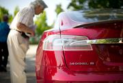 A shareholder examines a Model S sedan after attending the Tesla Motors (NASDAQ:TSLA) annual meeting in Mountain View, Calif. The sedan is one of two models the company currently offers.