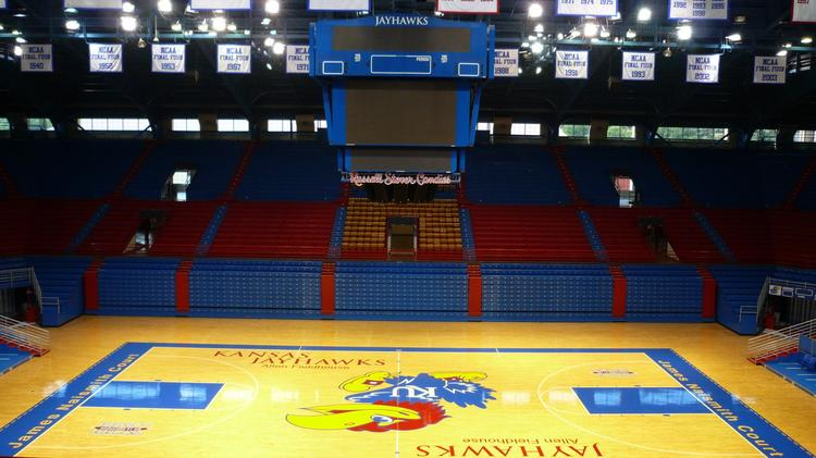 KU officials grabbed some prime student seats after students decided to reduce fees that go to the school's Athletic Department.