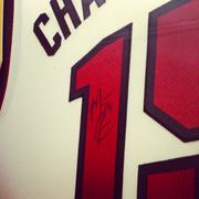A Miami Heat jersey, signed by Mario Chalmers, is open for bidding.  For a complete list of items up for grabs, go to the campaign's website.